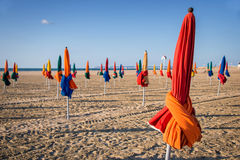 Colorful parasols on Deauville beach Stock Photo