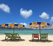 Colorful parasols and deck chairs Stock Photo