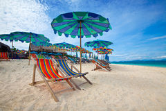 Colorful parasols on a tropical island Stock Photo