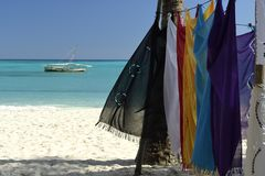 Pareo Cloths hanging at the beach in Nosy Iranja Madagascar stock photo