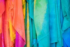 Colorful pareo and polynesian dress for sale at market Royalty Free Stock Photo