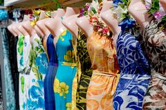Colorful pareo and polynesian dress for sale at market Stock Photography