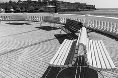 Benches on the embankment of Malta. Colorful park benches on the embankment of Valletta. Promenade on the background of the bay in Malta. Black and white picture Royalty Free Stock Photos