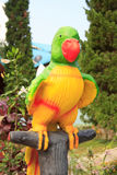 Colorful parrot statue in public park royalty free stock photo