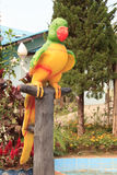 Colorful parrot statue in public park royalty free stock images