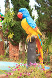 Colorful parrot statue in public park royalty free stock image