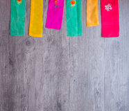 Colorful part of korean dress on wood background Royalty Free Stock Photos