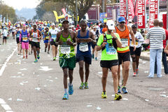 Colorful Participants Competing in the 2014 Comrades Marathon Ro Stock Photos