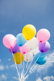 Colorful party balloon floating in mid air Royalty Free Stock Image