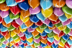Colorful party balloons background. Colorful helium party balloons - rainbow ballons - PortAventura's decoration near main entrance royalty free stock photography