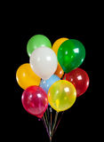 Colorful party balloons on black background Stock Photos