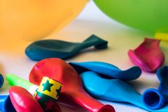 Colorful party balloons, out of the box to celebrate an event royalty free stock photo