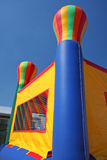Colorful party bounce house. A colorful bounce house or bouncy castle is outside on a sunny day. This is a fun place for children to burn some energy Stock Photography