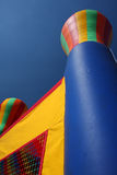 Colorful party bounce house. A colorful bounce house or bouncy castle is outside on a sunny day. This is a fun place for children to burn some energy Stock Images