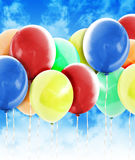 Colorful Party Celebration Balloons in Sky. A group of colorful balloons are in the sky to represent a birthday, anniversary or celebration event. Add your text Royalty Free Stock Photo