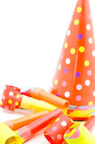 Colorful party hats and party whistles Stock Image