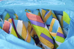 Colorful Party Napkins. Festive, brightly-colored, rolled napkins nestled into a bright, blue wrap royalty free stock photography
