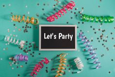 Colorful party streamers, gold little stars and blackboard Stock Photos