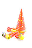 Colorful partyhats and party whistles Royalty Free Stock Photo
