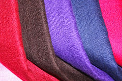 Colorful pasmina shawls. Colorful folded pasmina shawls closeup Royalty Free Stock Photography