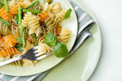 Colorful pasta with asparagus and rocket pesto Royalty Free Stock Photo