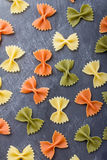 Colorful pasta background. Some colorful pasta background on a slate stock images