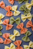 Colorful pasta background. Some colorful pasta background on a slate plate stock photos