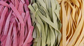 Colorful pasta fettuccine background Stock Photos