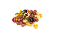 Colorful pasta hearts Stock Images