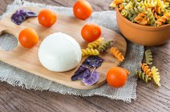 Colorful pasta with ingredients Stock Images