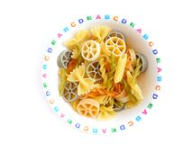 Colorful pasta in kids bowl Stock Photography