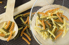 Colorful pasta in kitchen Stock Photography