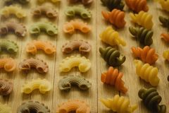 Colorful pasta with nice shapes lined royalty free stock images