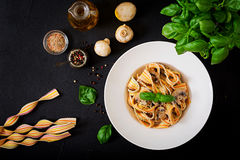 Colorful Pasta pappardelle with mushrooms in cream sauce Stock Photos