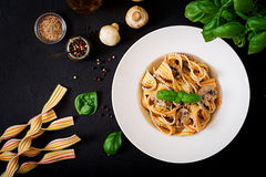 Colorful Pasta pappardelle with mushrooms in cream sauce. Stock Photos