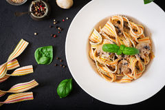Colorful Pasta pappardelle with mushrooms in cream sauce. Royalty Free Stock Images