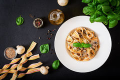 Colorful Pasta pappardelle with mushrooms in cream sauce Royalty Free Stock Images