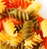 Colorful pasta spirals. Against a white background royalty free stock photography