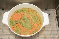 Colorful pasta in strainer Royalty Free Stock Photography