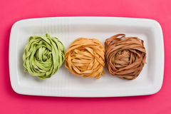 Colorful pasta tagliatelle Royalty Free Stock Images