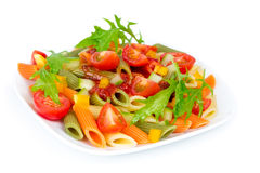 Colorful pasta on a white plate Stock Images