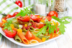 Colorful pasta on a white plate Royalty Free Stock Photography