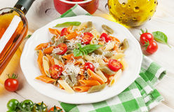 Colorful pasta and and white wine Stock Images