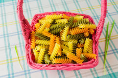Colorful pasta in a wicker basket. Royalty Free Stock Image