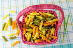 Colorful pasta in a wicker basket. Stock Photo