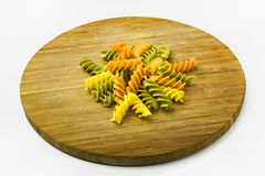 Colorful Pasta on Wooden Cutting Board. Studio Shot Royalty Free Stock Photos