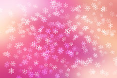 Colorful pastel abstract background with snow flakes falling. Stock Image