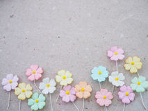 Colorful pastel artificial flower on recycled paper background Royalty Free Stock Photography