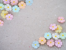 Colorful pastel artificial flower on recycled paper background, Stock Photos