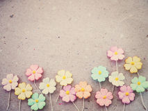 Colorful pastel artificial flower on recycled paper background Stock Photography
